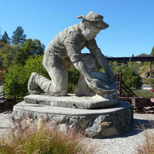 I can't even remember if this is the gold miner statue I saw.  (Google image)