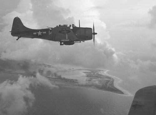 SBD_Dive_Bomber_over_Wake_Island,_1943